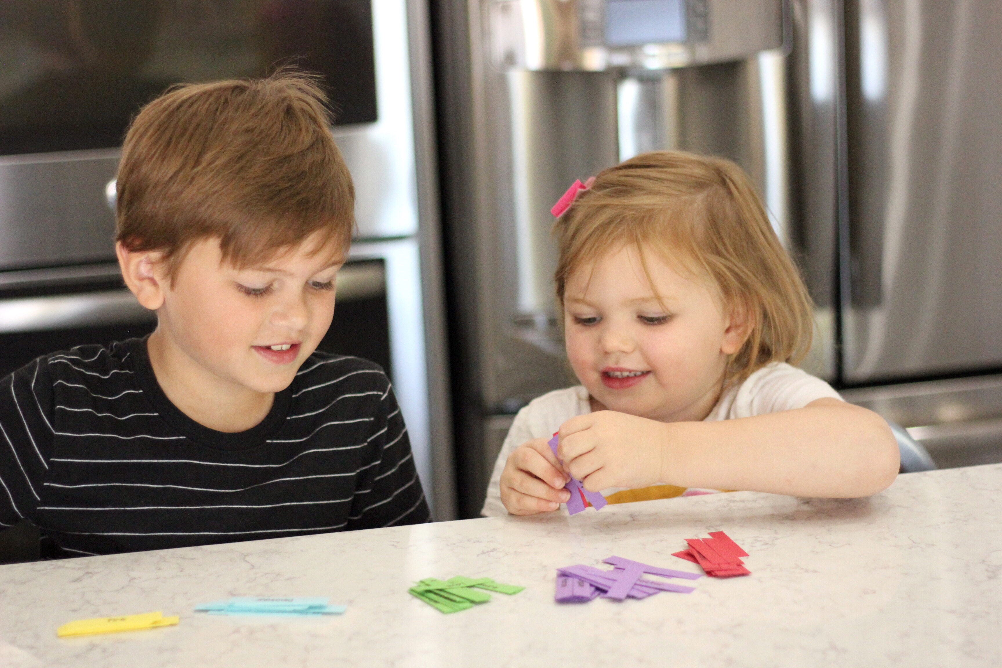 A girl and boy happily playing a game together