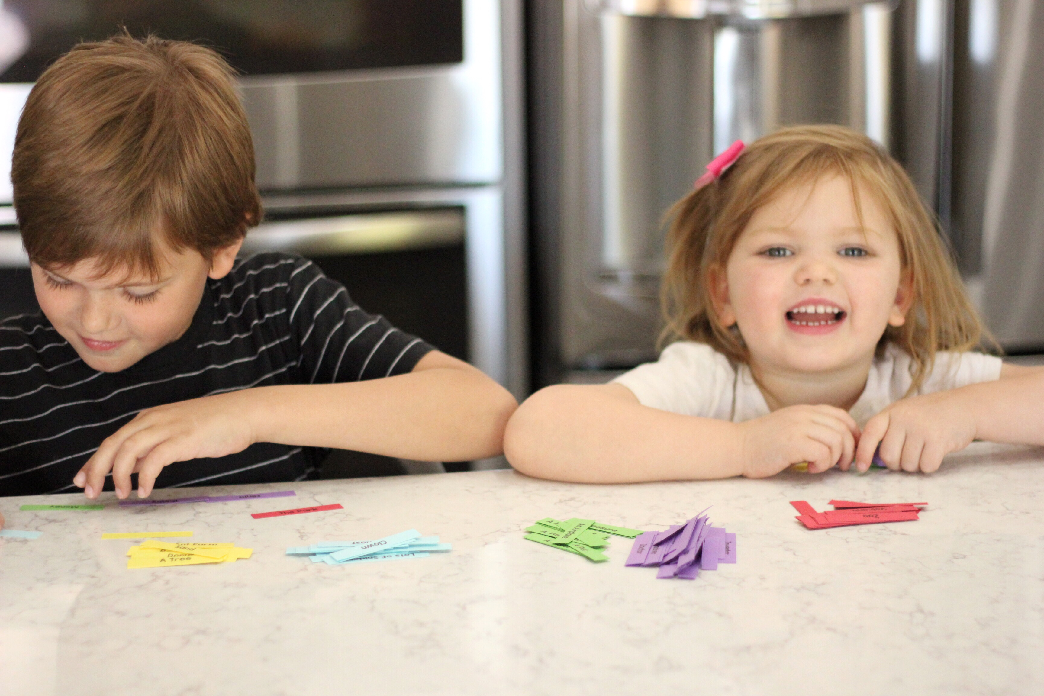 A boy and girl playing a story game.