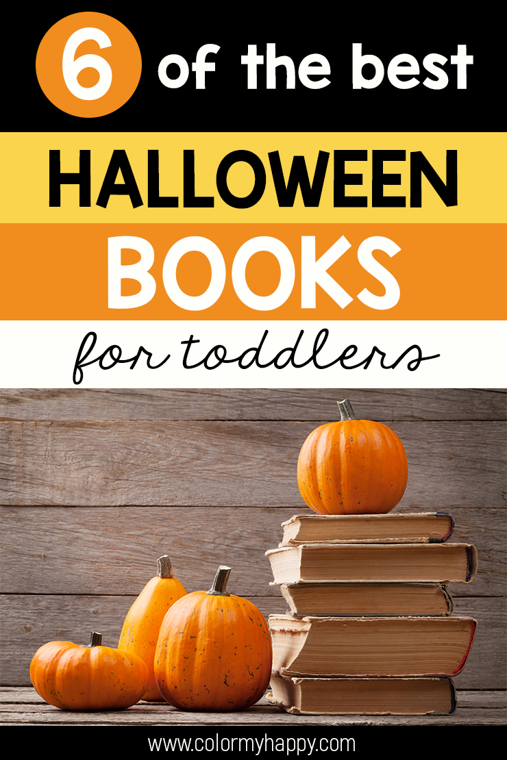 A stack of books surrounded by tiny pumpkins