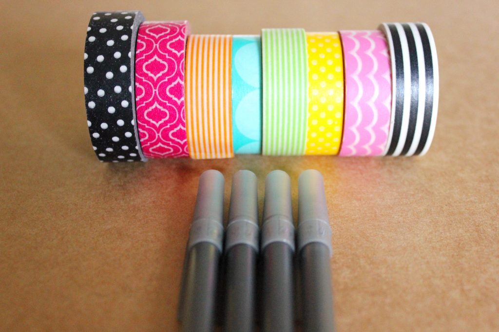 A row of washi tape on top of a row of pens
